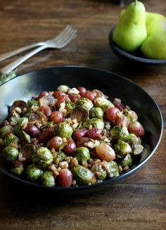 Pomegranate Roasted Brussels Sprouts with Red Grapes and Farro | 27 Brussels Sprout Recipes That Want To Celebrate Thanksgiving With You