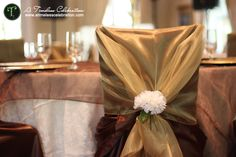 Brown and Gold chair covers with sash