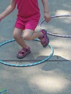 Hopping Hula Hoop Game | Teach Preschool preschool hula hoop activities, preschool outdoor games, games for gross motor skills, outdoor games for preschoolers, hoop game, hoop preschool activities, kid