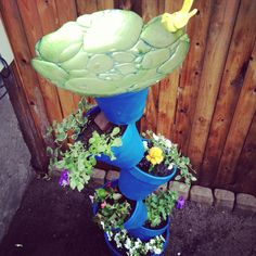 Whimsical flower pot.  On a spin from another post, I did a darker shade of blue with a yard sale bowl find!  My brothers and sister in law's garden now has a pop of color!  So fun and cool to make!
