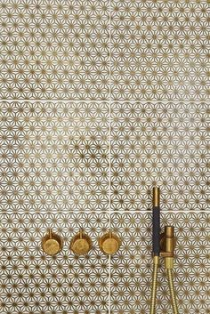 Brass and gold tile shower