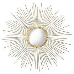 gold sunburst mirror for over master bed