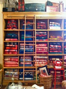 Vintage plaid blankets on display at a store called Brimfield in Chicago, Illinois.