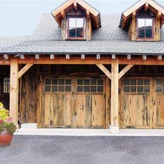 Rustic homes call for equally relaxed wood garage doors. Shown: Carriage House Door Co. model 3020K insulated wood sectional with reclaimed barnboard, $5,000; carriagedoor.com