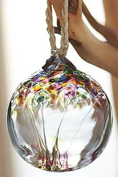 "Glass ""witch"" ball - hung in an east facing window to protect the home and ward against detriment."