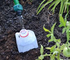 Make a slow drip irrigation device by cutting small slits in the bottom and sides of a plastic soda pop bottle, milk jug, juice bottle or other plastic container. Bury the bottle partway in the soil near your plants. You can fill the bottle quickly and the water will drip slowly into the soil.
