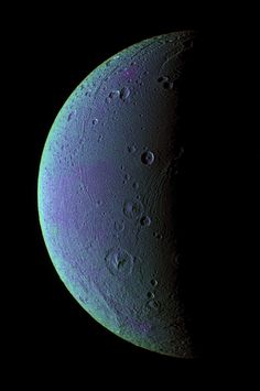 "Dione (false-color image) 2005. Fourth-largest moon of Saturn, orbiting at about the same distance as our Moon orbits Earth. It has a varied terrain, is probably made mostly of water ice with a rocky core, and has a tenuous atmosphere. (Image: NASA/JPL/SSI) ©Mona Evans, ""10 Amazing Facts about Saturn's Moons"" http://www.bellaonline.com/articles/art28136.asp"