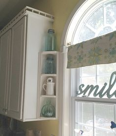 I like the word smile in the window and i also like the tinted jars