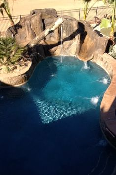 Beautiful pool with rope swing and slide