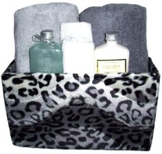 Snow Leopard Space Saver.  Perfect location for all your toiletries. Great for towels, washcloths, lotions, colognes, perfumes. On the counter or vanity, on top of the commode, on the floor. $43.99  SALE $33.00 lotion, snow leopard, leopard bathroom