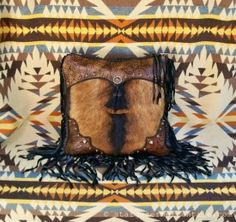 Our #Western style brown and black #leather #pillow with hair-on cowhide and copper conchos has a rugged, traditional Western look. . .cowboy cool!  http://stargazermercantile.com