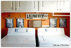 """Like the """"photo hangers"""".  Love the black & white photos of the child playing in the laundry basket. Like the bright color wall."""