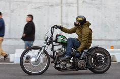 Shovelhead hardtail custom with short apes, jockey shift and black sportster tank with green AMF stripes