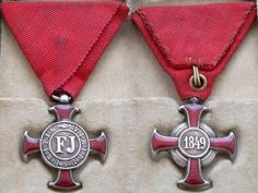 Silver Cross of Merit Without Crown.  1848-1918 and enamels, mounted on original civilian type ribbon. Cross measures 30mm from period 1849-1860. The order was designated by emperor Franz Joseph and it was introduced to the 2nd dec 1849.It was award for many years service in public and government services.