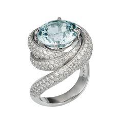 "Brides.com: Unique Engagement Ring Settings ""Trinity de Cartier"" aquamarine and diamond 18K white gold engagement ring, price upon request, Cartier  See more Cartier engagement rings.Photo: Courtesy of Cartier"