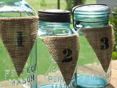 Country Wedding Burlap Table Number Mason Jar Centerpiece Wedding Decorations Burlap Pendant Table Numbers With Twine Rustic Wedding. $2.50, via Etsy.