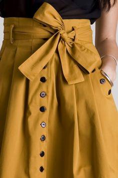 button bow mustard skirt
