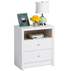 This chic, cosmopolitan-design Nolita nightstand combines elegant details with modern lines and features a pure white laminate finish with diamond-cut chrome knobs and two sizable drawers and an open shelf for added storage and organization.
