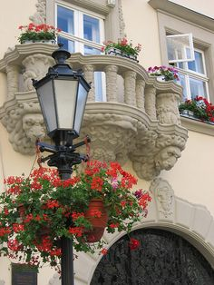 Beautiful balconies of Rynok Square in Lviv, Ukraine (by goeneas).