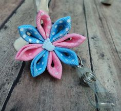Retractable Id Badge Holder OB Nurse Pink and Baby Blue Swiss Ribbon Flower Badge Reel ID. $9.95, via Etsy.