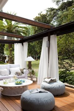 Open air patio with soft furnishing.