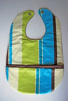Baby bib made from a vinyl tablecloth