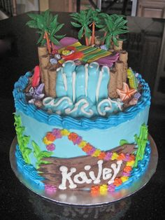 Sweet little girl's luau themed birthday cake
