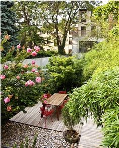 i love how these bright red contemporary chairs really pop in the garden.