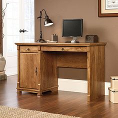 This Traditional European style Computer Desk with a  rich American Chestnut finish is accented with elegant Spanish hardware