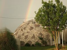 A Rainbow over a Rental at The Monolithic Dome Insitute