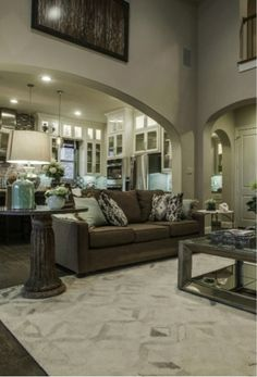 Imagine laughing and sharing memories with #family during the #holidays this fall in your new #livingroom that opens to the #gourmet #kitchen through a decadent #arched #entryway.