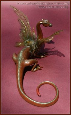 Fairy Dragon by Erin ´EireWolf´ Metcalf. Love the long tail and delicate wings. Made of polymer clay and mixed media.