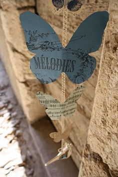 Guirlande de papillons en papier et dentelle