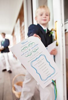 At the ceremony, the ring bearers handed out programs. Ryan Jensen Photography.