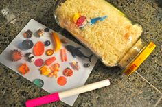"""DIY """"I SPY"""" Jar - fill empty bottle with rice and little things to find (small erasers are cute).  Before hiding them, take a picture of them all together, then print it out and laminate it so they can use a DRY ERASE MARKER to check off as they find things."""
