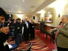 Pastor John Hagee praying over the partners in London, England in Dec 2011
