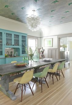 this is one of the most beautiful homes I've seen in a long time. The color palette here is hot, but what really pulls me in is all the clever little details - see dining room ceiling! Take a peek around and tell me which room is your favorite.