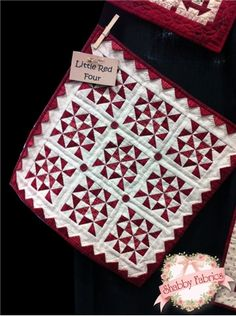 "Little Red Four Kit: This darling little quilt is a breeze to make and will add a touch of sweetness to any table or wall! Pinwheel blocks and prairie points are so sweet in red and cream. Kit includes pattern all top fabrics, border, binding, backing, and buttons. Quilt finishes to 17 1/2"" x 17 1/2""."