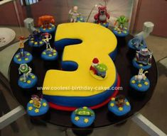 Homemade Toy Story 3rd Birthday Cake: This Toy Story 3rd Birthday Cake was for my son's 3rd birthday! All about Toy Story.  I baked a big sheet of chocolate cake and cut it in to a 3. I crumbcoat