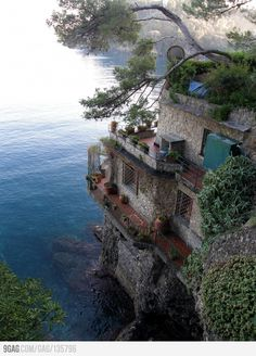 Perched against a cliff rising from the sea in Portofino, Italy, stunning.