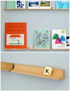 Scrabble letter racks, in wood, are brilliant for displaying ephemera. Just glue to your walls.