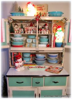 Hoosier cabinet full of vintage snowmen and PYREX!!! I need one of these cabinets!