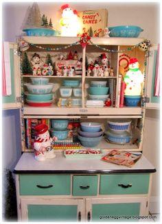 Hoosier cabinet full of vintage snowmen