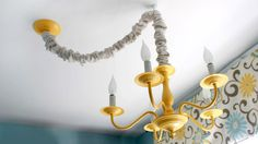 From boring brass chandelier to cheery, modern fixture in five easy steps.