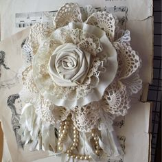 Nice idea - flower corsage made from combination of handmade fabric rose, rosette, gathered ruffles, crochet doily, ribbon and pearl strand.