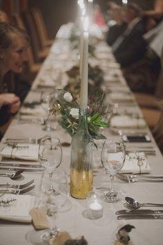 gold glitter-bottomed bottles, photo by Katie Purnell http://ruffledblog.com/intimate-irish-wedding #centerpieces #reception #gold