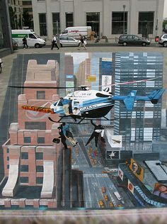 the beautiful 3D chalk art of Julian Beever. Julian is famous for his incredible 3D chalk art he draws in the streets. It is carefully drawn at incredible angles so that when the viewer stands in front of it, the art looks like it jumps off the street completely in 3D. His 3D chalk art is often drawn in long stretches of pavement.