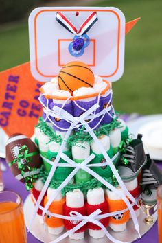 Sports inspired diaper cake by Creative Couture, LLC. Visit creativecouture.org OR facebook.com/CreativecoutureLLC for more details.