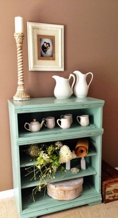 Thrift Store find. Old dresser. Removed drawers and painted with chalk paint. Everything but owl coffee mugs found at thrift store.