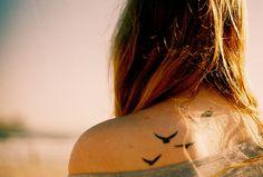 Surfer girl bird tattoos.